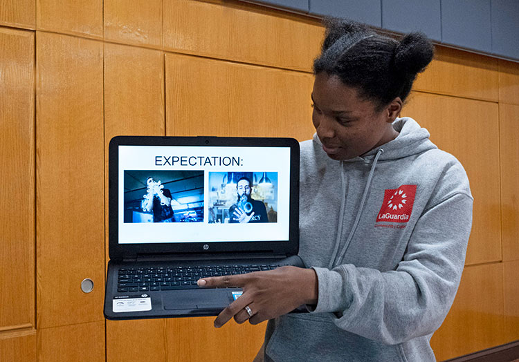 student looking at laptop with her presentation displayed