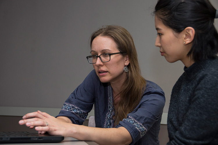 Professor and student working together